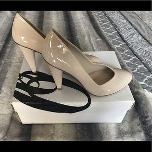 Nine West cream colored heels.